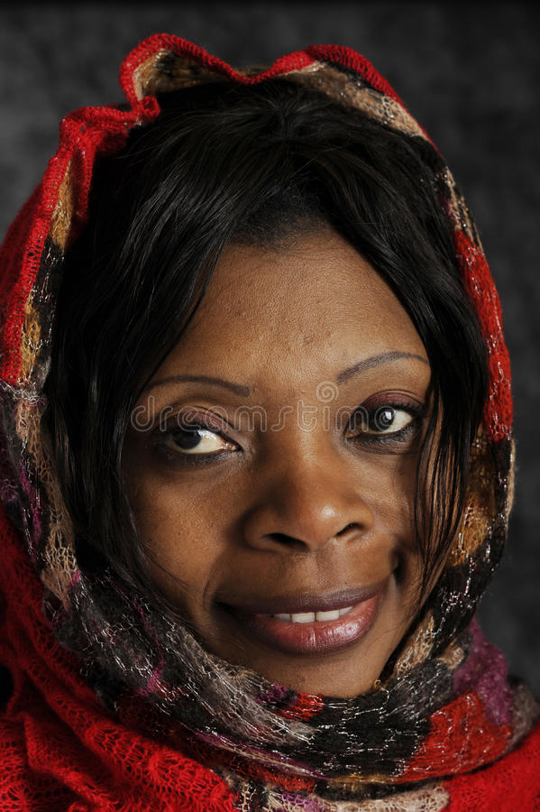 Portrait of african woman. Wrapped in a red shawl royalty free stock image