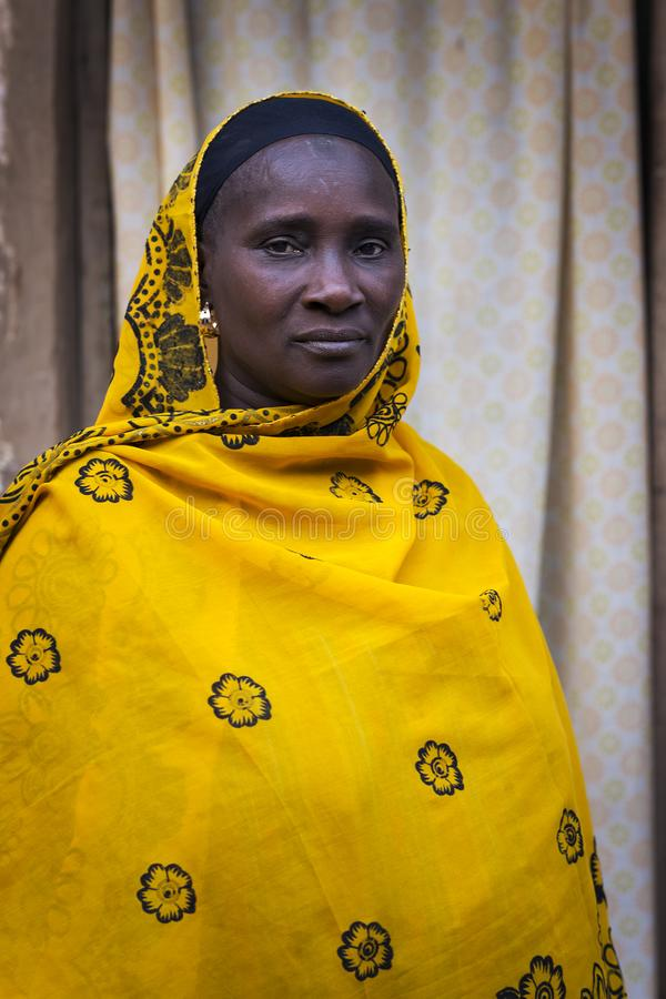Portrait of an African woman wearing a hijab in a slum of the city of Bissau, in Guinea-Bissau. Bissau, Republic of Guinea-Bissau - January 29, 2018: Portrait of royalty free stock images
