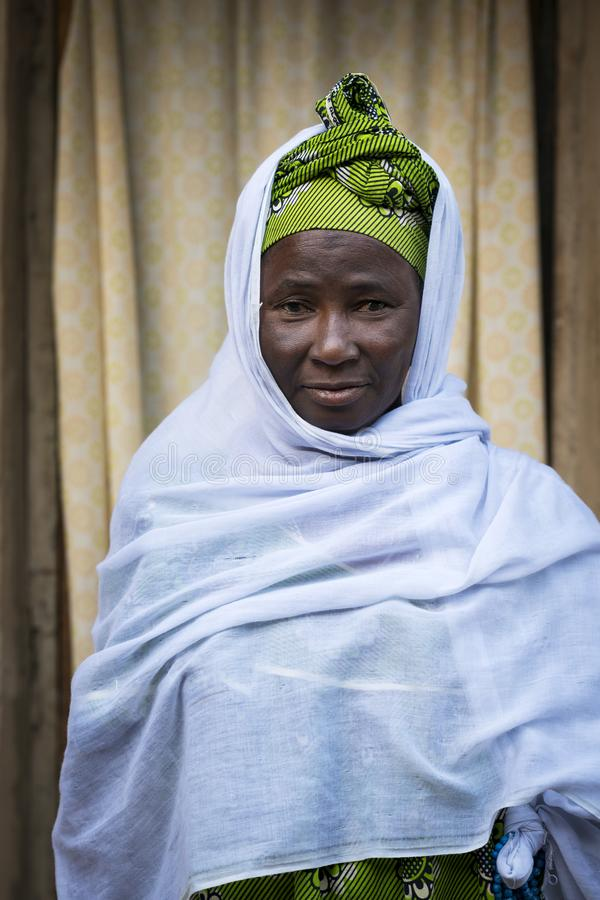 Portrait of an African woman wearing a hijab in a slum of the city of Bissau, in Guinea-Bissau. Bissau, Republic of Guinea-Bissau - January 29, 2018: Portrait of stock photo