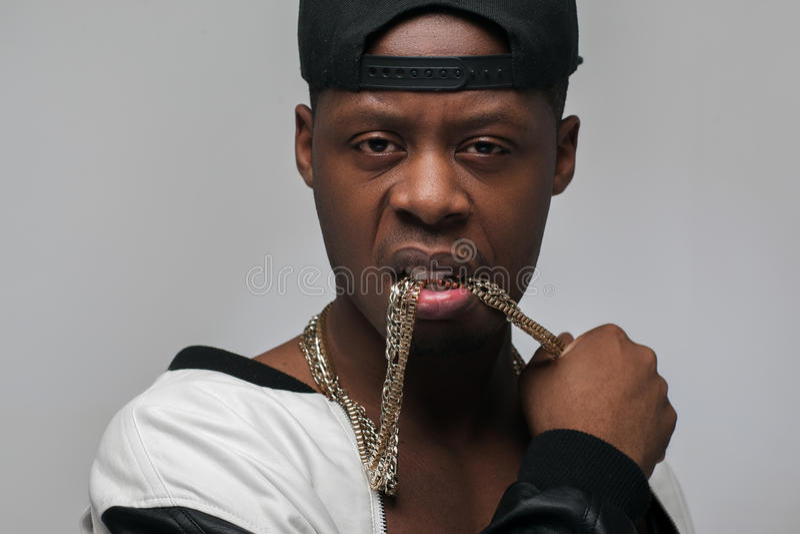 Portrait of afroamerican guy. Rich proud gangster. stock photos
