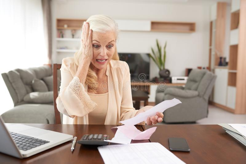 Woman paying bills royalty free stock photo