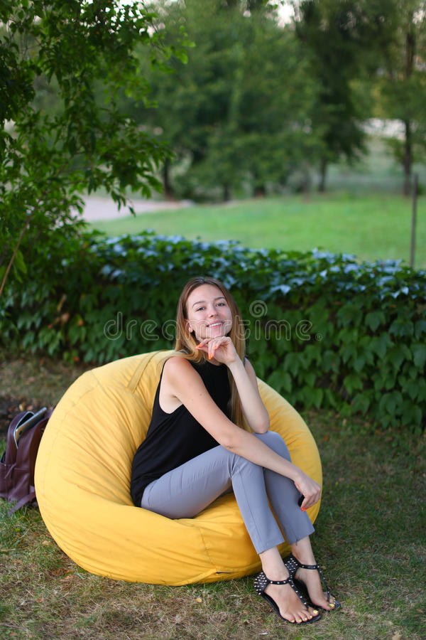 Portrait of alluring girl smiling at camera and photographer sit royalty free stock photos