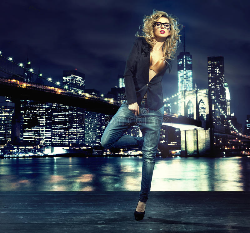 Portrait of alluring lady over the night city stock images