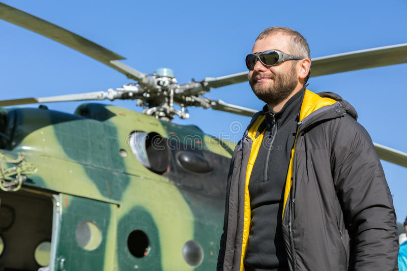Portrait of Alpine Climber Preparing for Boarding to Helicopter royalty free stock photography
