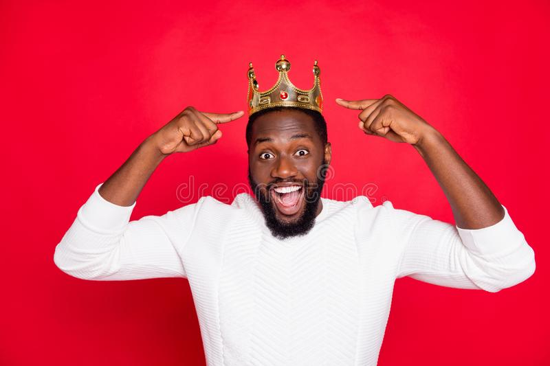 Portrait of amazed crazy afro american beard man point at his crown scream wow omg win prom party competition become. Portrait of amazed crazy afro american royalty free stock photos