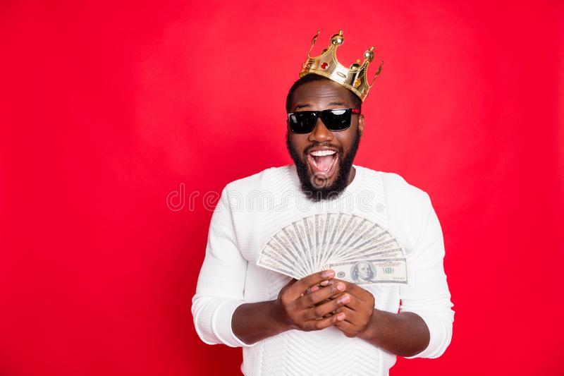 Portrait of amazed surprised crazy funky dark skin man with brown hair beard hold fan money win jackpot in x-mas casino. Portrait of amazed surprised crazy funky stock image