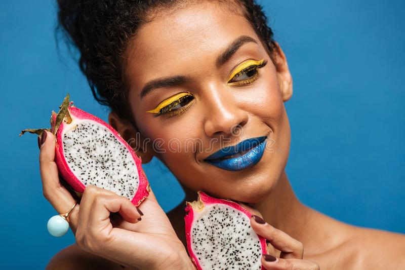 Portrait of amazing mulatto woman with bright makeup enjoying ex royalty free stock photography