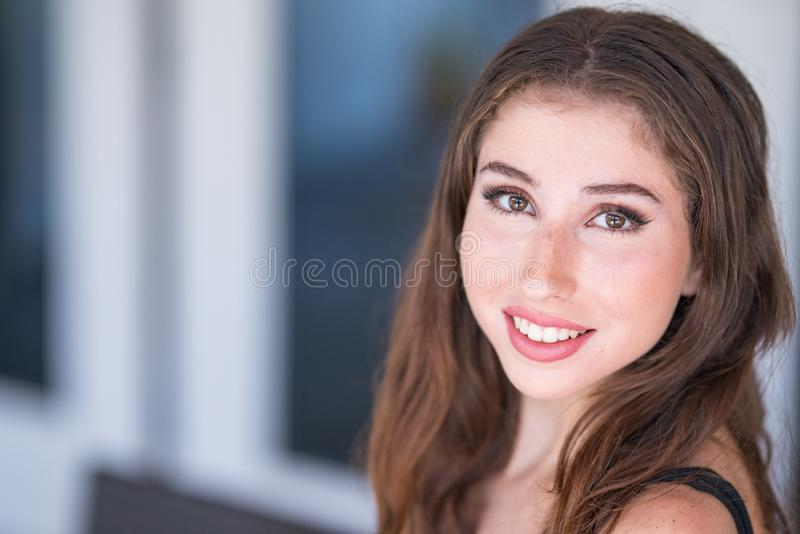 Portrait of an amazing young woman smiling at camera stock images