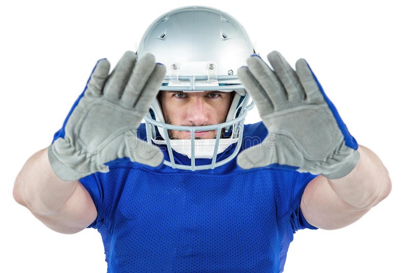Portrait American football player defending. Against white background royalty free stock photos