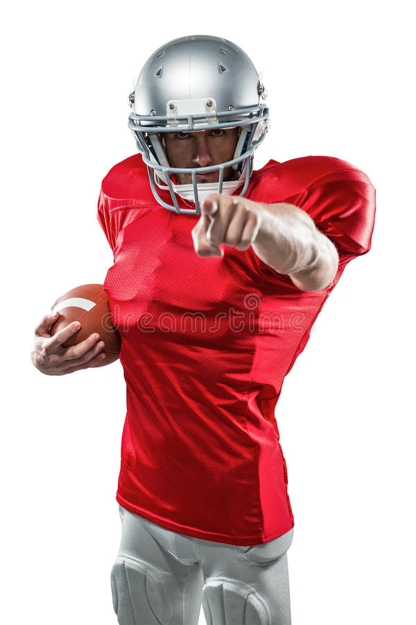 Portrait American football player in red jersey pointing. Against white background royalty free stock image