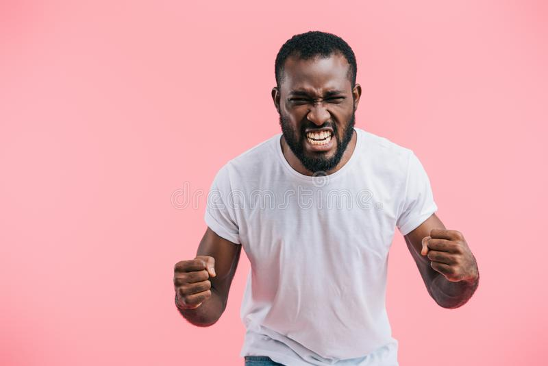 portrait of angry african american man in white shirt stock photo