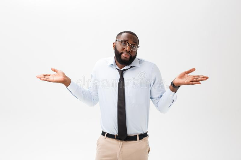 Portrait of angry or annoyed young African American man in white polo shirt looking at the camera with displeased. Expression. Negative human expressions stock photo