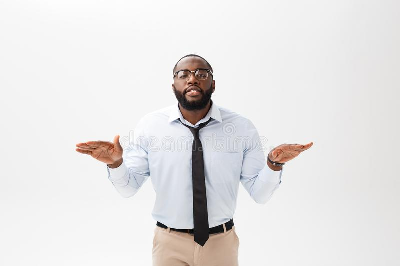 Portrait of angry or annoyed young African American man in white polo shirt looking at the camera with displeased. Expression. Negative human expressions stock photos
