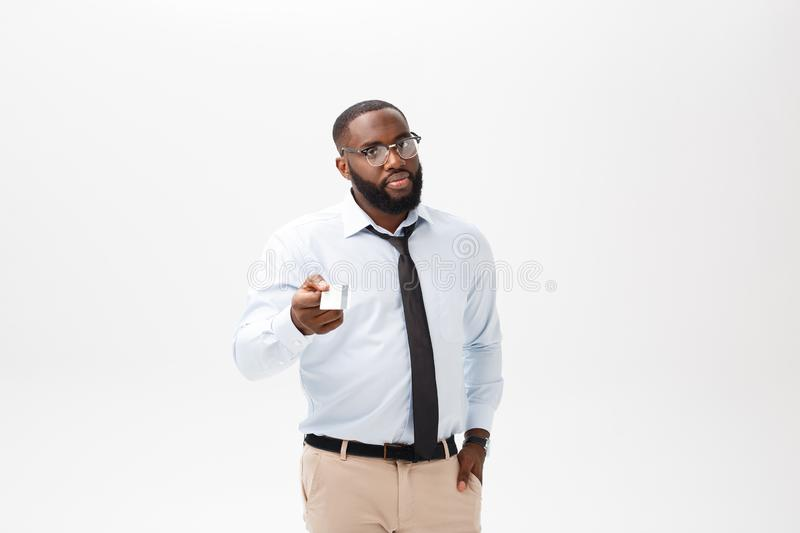 Portrait of angry or annoyed young African American man in white polo shirt looking at the camera with displeased. Expression. Negative human expressions royalty free stock photography