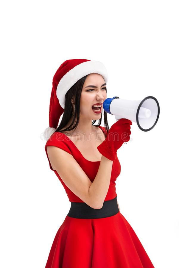 portrait of angry asian woman in santa claus costume with megaphone royalty free stock images