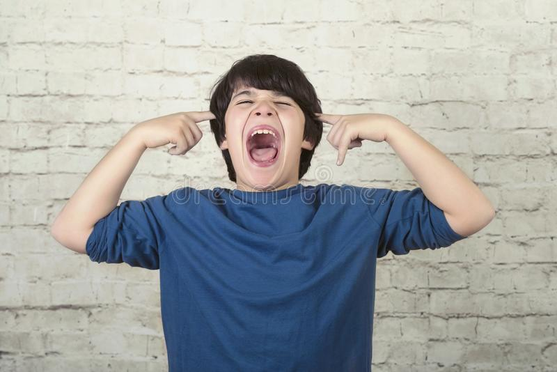 Portrait of angry Boy Shouting royalty free stock photos