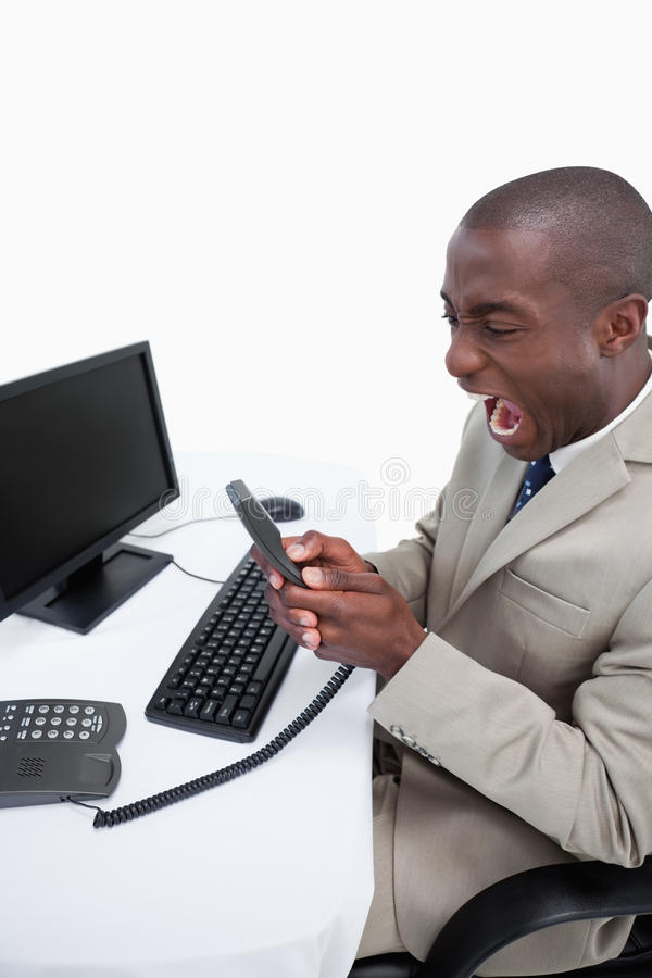 Download Portrait Of An Angry Businessman Answering The Phone While Using Stock Photo - Image: 22693192