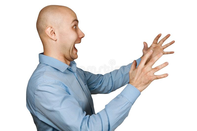 Portrait angry dangerous bald man trying to watch and scare on white isolated background.  stock photography