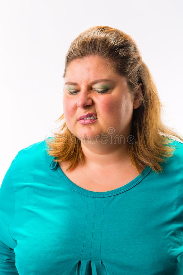 Close-up of an angry fatty woman royalty free stock photos