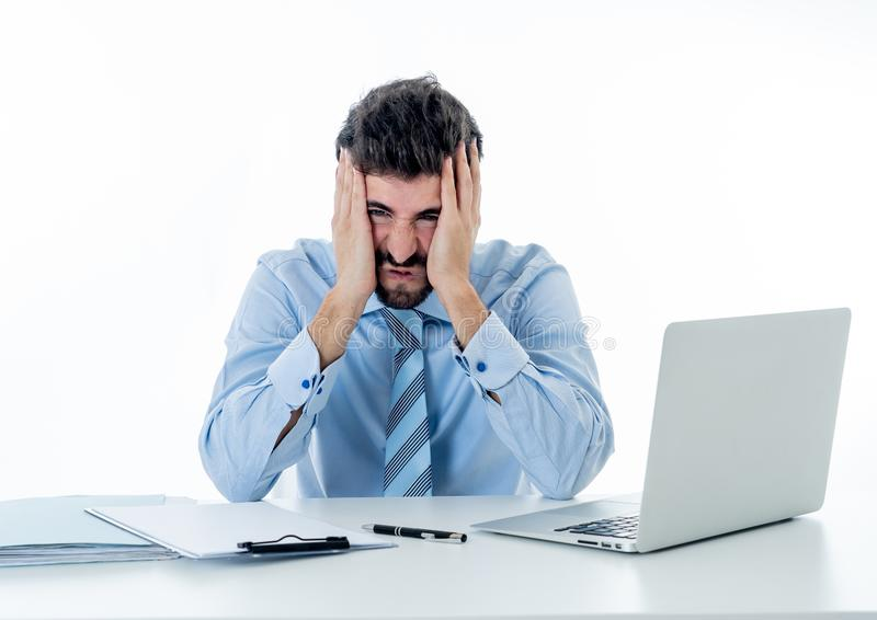 Portrait of angry and frustrated businessman shouting at laptop desperate, overworked and stressed royalty free stock images