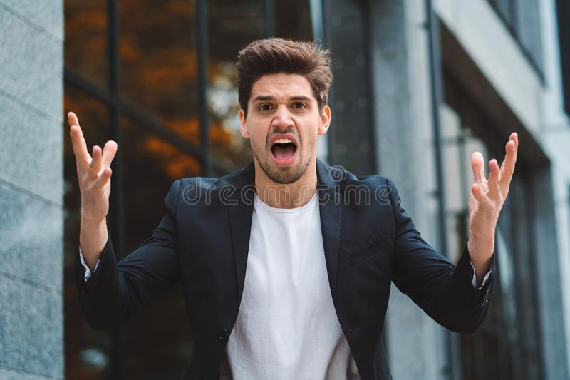 Portrait of angry furious businessman, having nervous breakdown at work, screaming in anger, stress management, mental royalty free stock photography