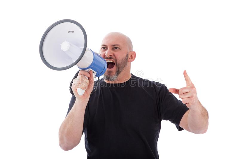 Portrait of angry man shouting with a megaphone. Bearded man yelling into a megaphone royalty free stock image