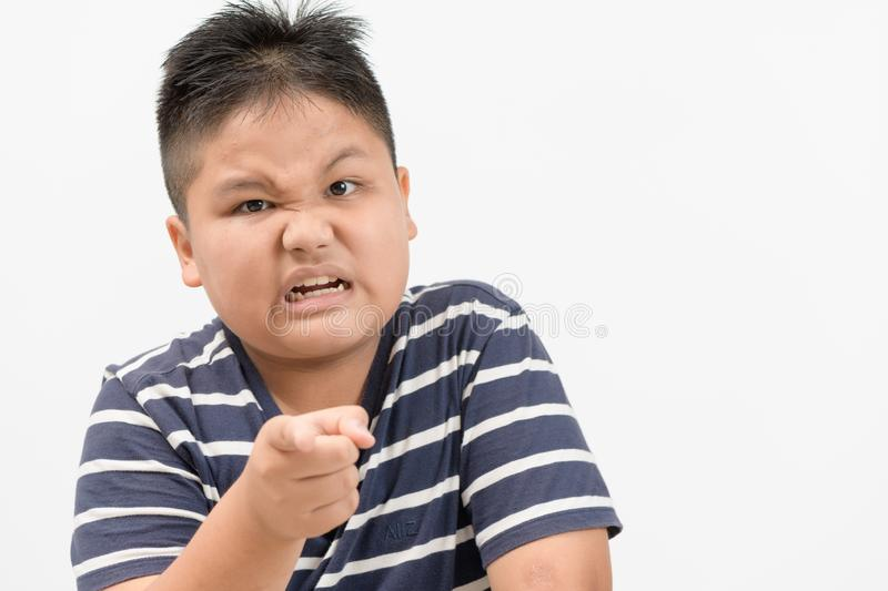 Portrait of a angry obese boy isolated royalty free stock images