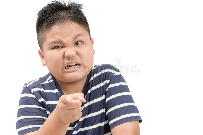 Portrait of a angry obese boy isolated stock photography