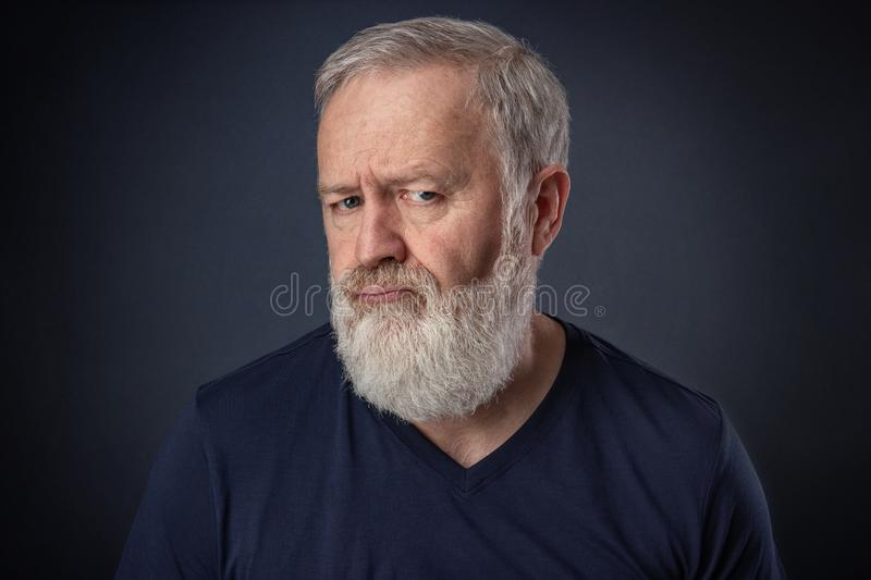 Portrait of an angry old man stock image