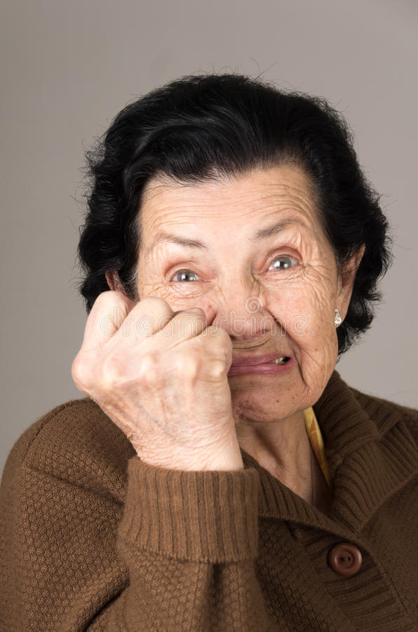 Portrait of angry old woman grandmother royalty free stock photography