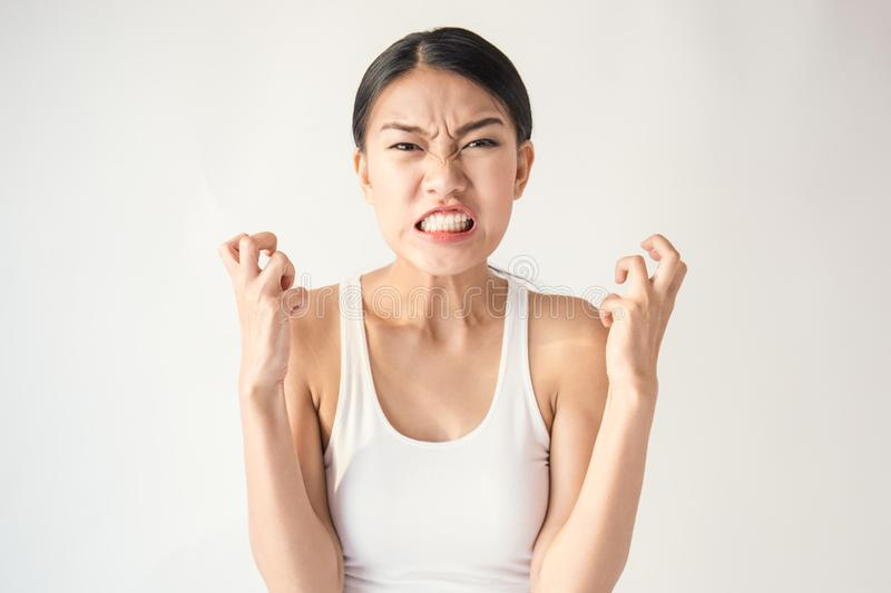 Portrait of angry pensive mad crazy asian woman screaming out expression, facial royalty free stock photo
