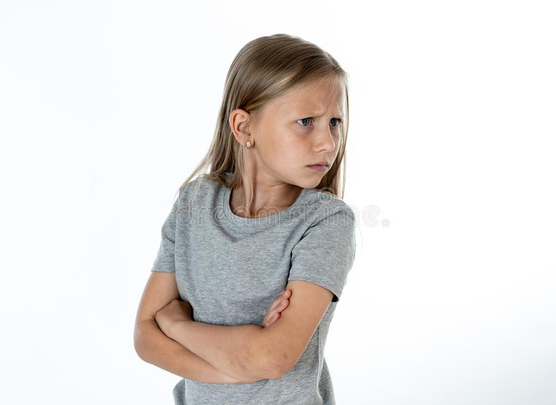 Close up portrait of angry and sad little blonde girl on white back ground royalty free stock photo