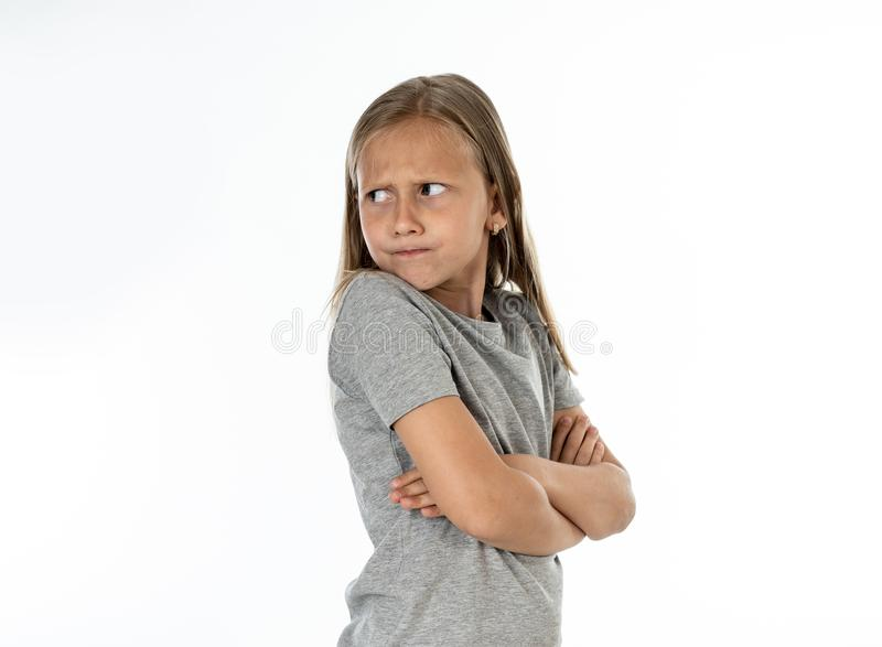 Close up portrait of angry and sad little blonde girl on white back ground stock images