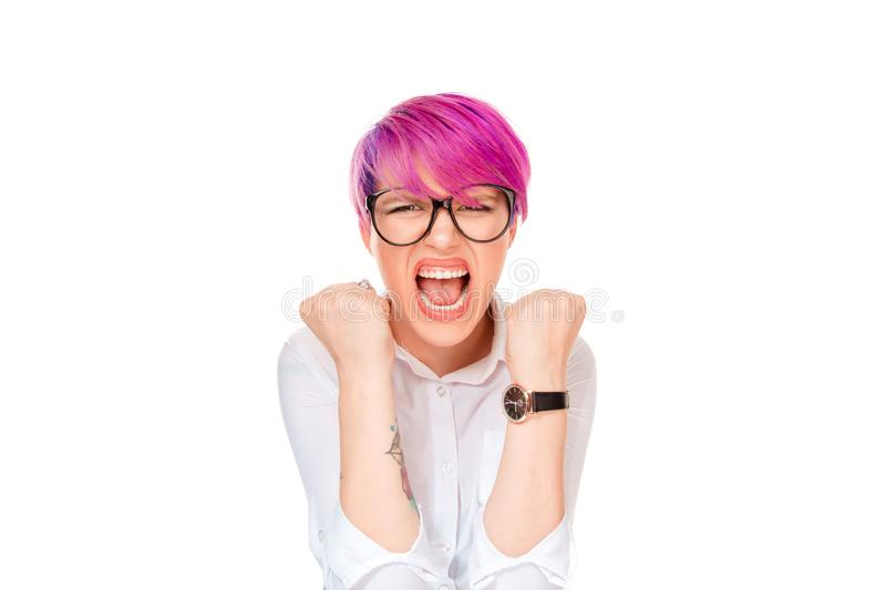Portrait angry young woman screaming fists clenched. Portrait angry young woman with eyeglasses screaming yelling fists clenched. Pink magenta hairstyle girl stock images
