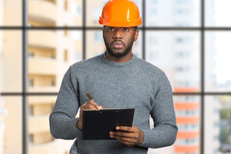 Portrait of architect with clipboard. stock photography