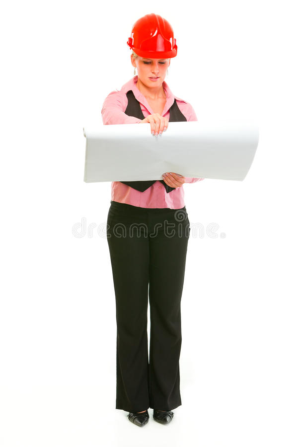 Portrait of architect woman checking plans royalty free stock photography