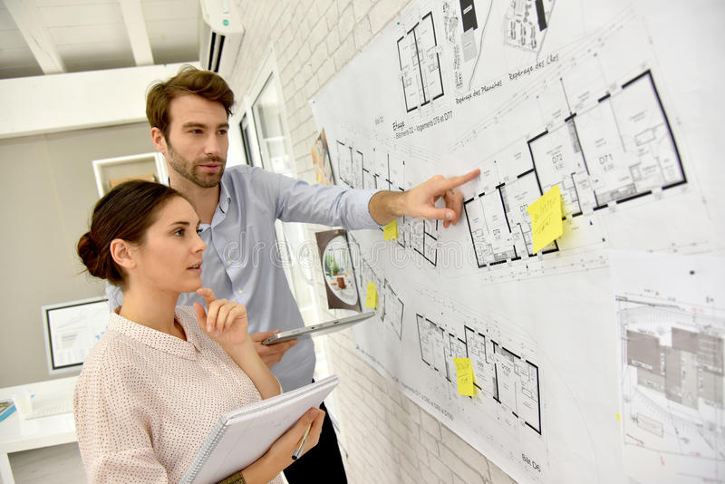 Portrait of architects working on a project stock photos
