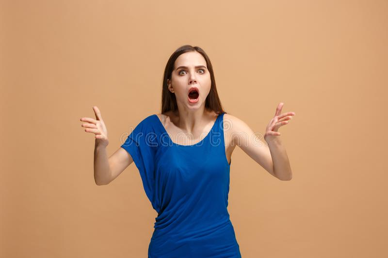 Portrait of an argue woman looking at camera on a pastel background. Argue woman. Aggressive angry business woman standing on trendy pastel studio background stock images