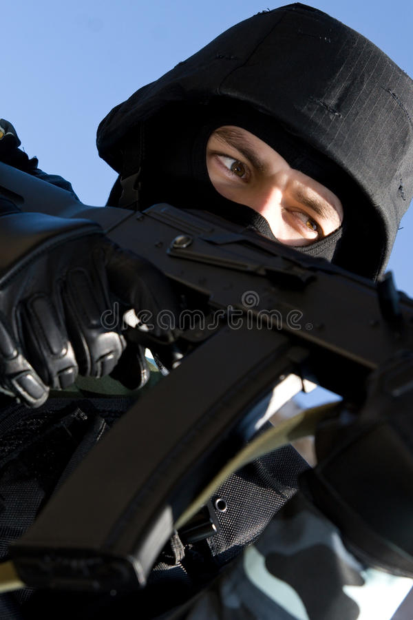 Portrait of an armed soldier in full ammunition royalty free stock image