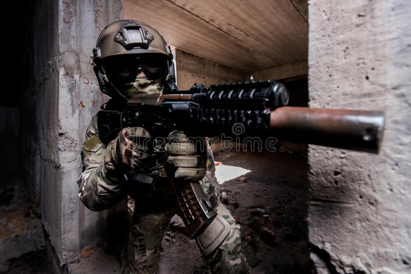 Portrait of armed soldier during the military operation in a bui royalty free stock photo