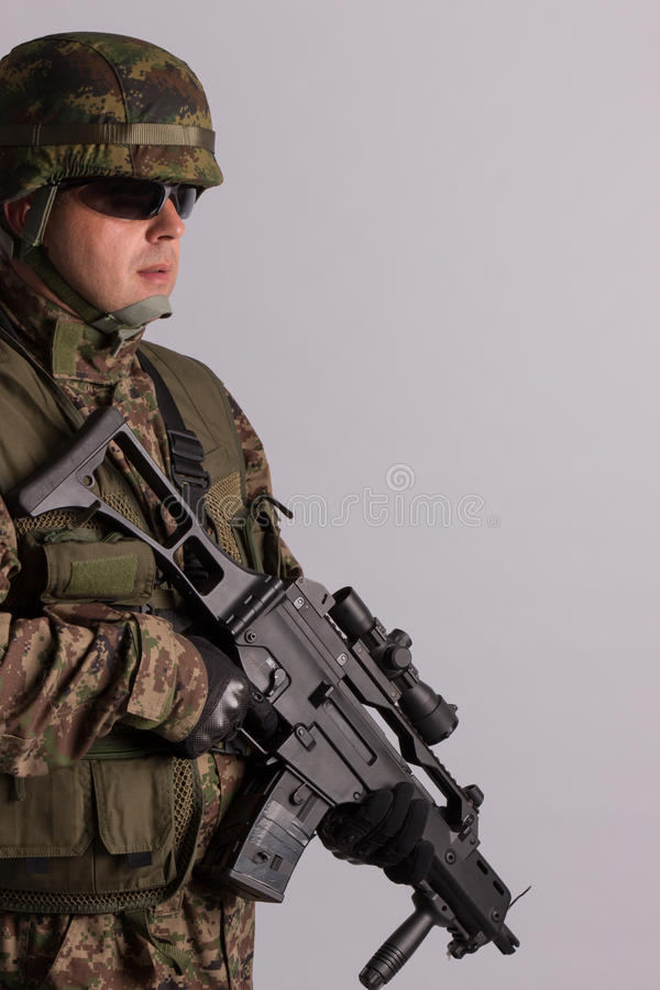Portrait of an armed soldier stock photo