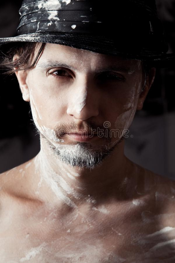 Portrait of artist-man with hat royalty free stock image