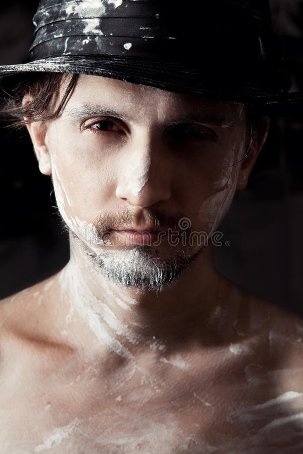 Portrait of artist-man with hat stock images