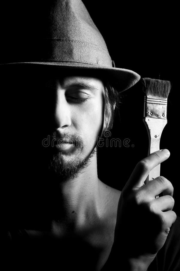 Portrait of artist-man with hat stock photography