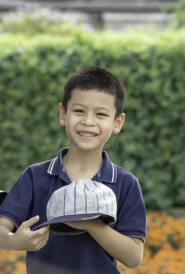 Portrait of Asean boy , laughing and smiling happily in the park royalty free stock photography