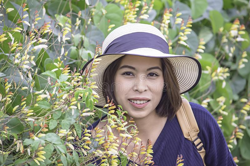 Portrait of Asean woman wearing a hat in the flower garden royalty free stock photos