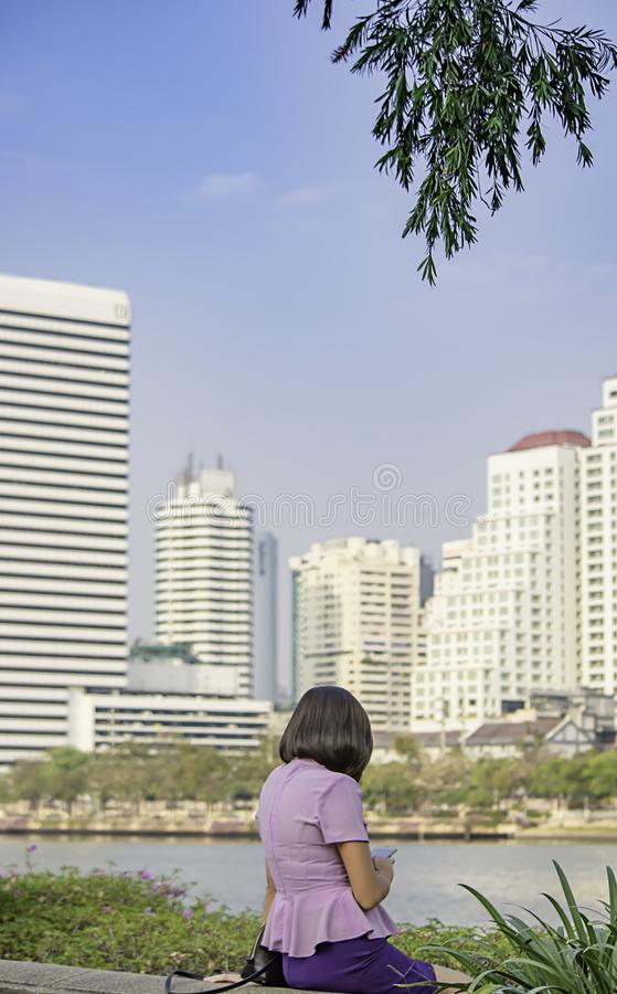Portrait of Asean Women with short hair brown Background Building blurry royalty free stock images