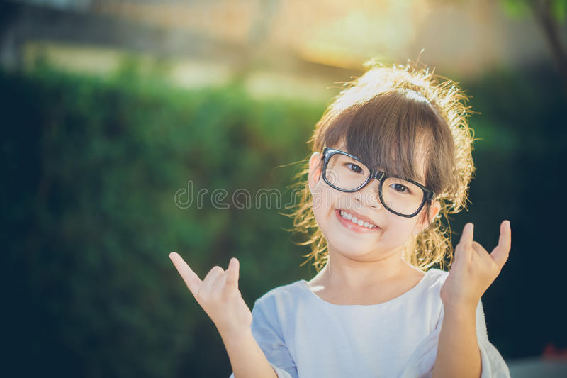 Portrait asia children feeling happy of sunlight. stock photography