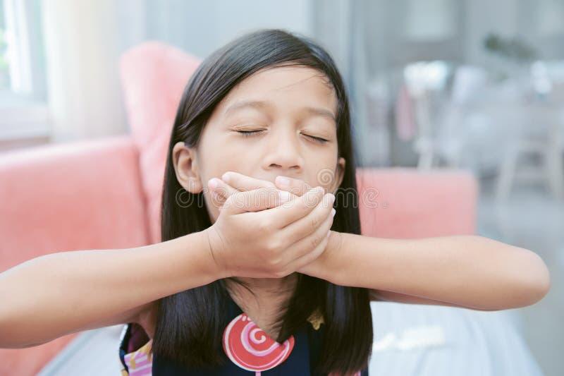 Portrait of asin lazy girl yawning stock photos