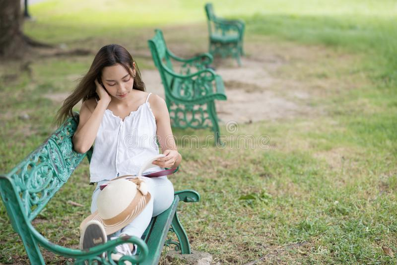Relax woman read book in park stock photo